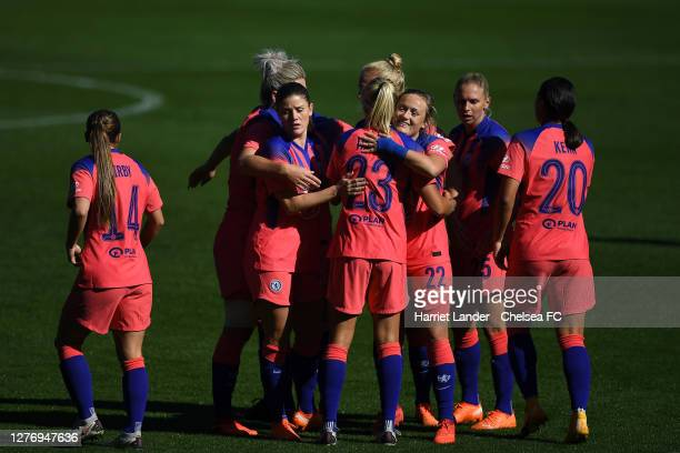 Erin Cuthbert of Chelsea celebrates with teammates after scoring her team's first goal during the Women's FA Cup Quarter Final Match between Everton...