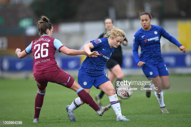 Erin Cuthbert of Chelsea is challenged by Laura Vetterlein of West Ham United during the Barclays FA Women's Super League match between Chelsea and...