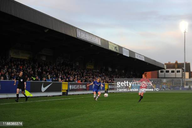 Erin Cuthbert of Chelsea is challenged by Martha Harris of Manchester United in front of a full stand during the Barclays FA Women's Super League...