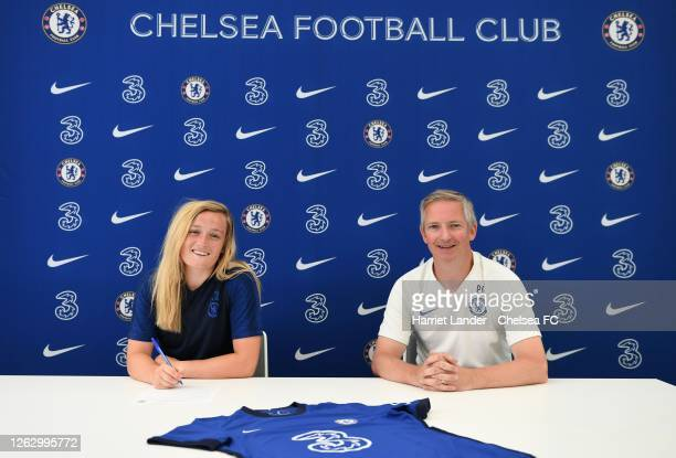 Erin Cuthbert of Chelsea poses for a photograph with Paul Green, Assistant Manager of Chelsea as she signs a new contract with Chelsea FC Women at...