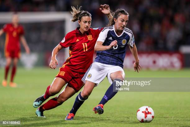 Erin Cuthbert of Scotland and Alexia Putellas of Spain battle for the ball during the Group D match between Scotland and Spain during the UEFA...