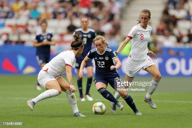 Erin Cuthbert of Scotland is challenged by Lucy Bronze of England and Jill Scott of England during the 2019 FIFA Women's World Cup France group D...
