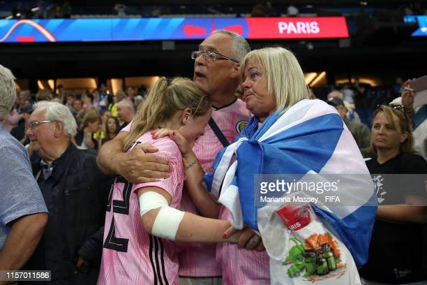 Erin Cuthbert of Scotland is consoled by family following the 2019 FIFA Women's World Cup France group D match between Scotland and Argentina at Parc...