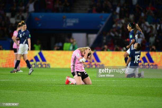 Erin Cuthbert of Scotland sinks to her knees after the referee orders a saved penalty to be retaken knocking her side out of the tournament in the...