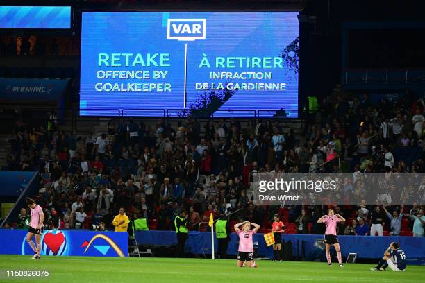 Erin Cuthbert of Scotland sinks to her knees after the referee orders a saved penalty to be retaken knocking her side out of the tournament following...