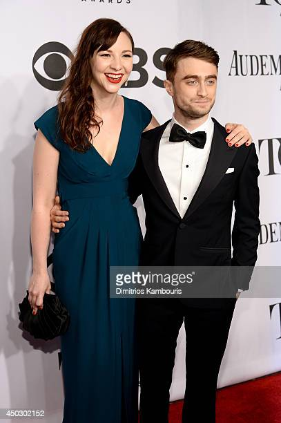 Erin Darke and Daniel Radcliffe attend the 68th Annual Tony Awards at Radio City Music Hall on June 8 2014 in New York City
