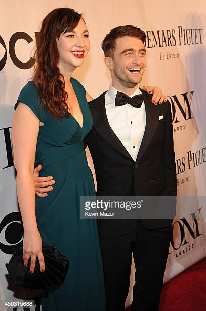 Erin Darke and Daniel Radcliffe attend the 68th Annual Tony Awards at Radio City Music Hall on June 8, 2014 in New York City.