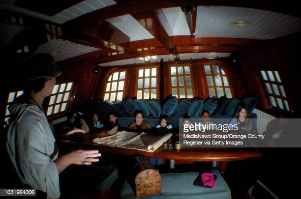 01/05/05 Erin Doak a volunteer aboard the Hawaiian Chieftain teaches students from Manhattan Academy about life life on ship in Rainbow Harbor in...
