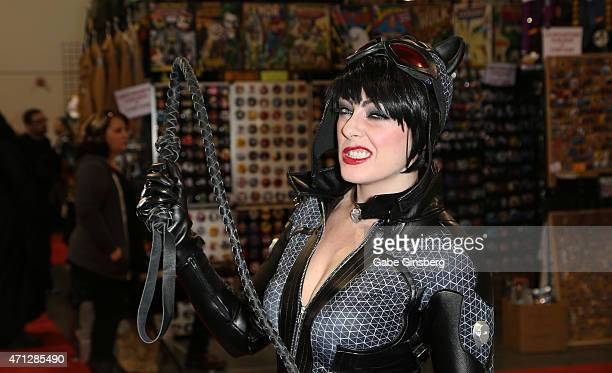Erin Fritzsching dressed as the character Catwoman from the Batman Arkham City video game attends Wizard World Comic Con Las Vegas at the Las Vegas...