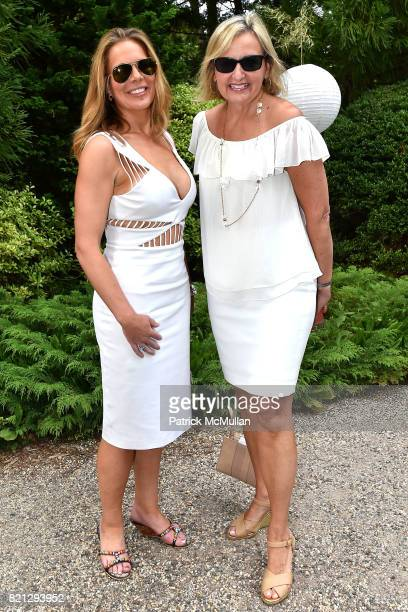 Erin Gibbs and Adriana PidwerBetsky attend Boom The Cosmic LongHouse Benefit at LongHouse Reserve on July 22 2017 in East Hampton New York