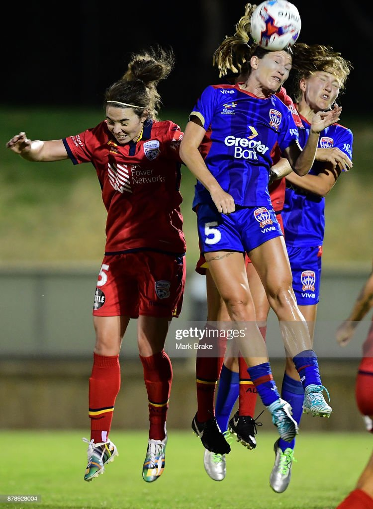 Erin Gilliland of Newcastle Jets heads in front of Jenna McCormick of Adelaide United during the round five W-League match between Adelaide United and Newcastle Jets at Marden Sports Complex on November 25, 2017 in Adelaide, Australia.