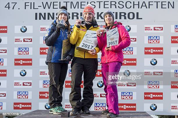 Erin Hamlin of the United States Tatjana Huefner of Germany and Kimberley McRae of Canada pose for a picture at the victory ceremony of the Women's...