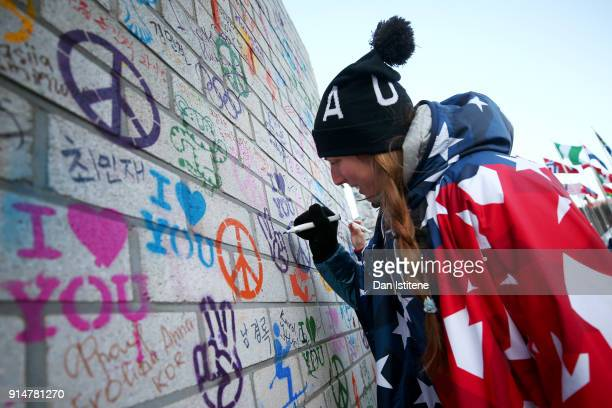 Erin Hamlin of the United States writes a message on the Truce Wall after the team's flag raising ceremony during previews ahead of the PyeongChang...