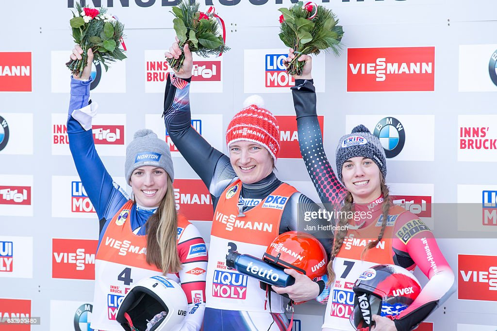Erin Hamlin of the USA, Tatjana Huefner of Germany and Kimberley McRae of Canada pose for a picture during the flower ceremony of the Women's Luge competition during the second day of the FILWorld Championships at Olympiabobbahn Igls on January 28, 2017 in Innsbruck, Austria.