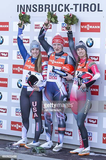 Erin Hamlin of the USA Tatjana Huefner of Germany and Kimberley McRae of Canada pose for a picture during the flower ceremony of the Women's Luge...
