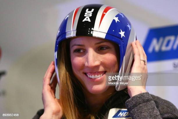 Erin Hamlin tries on the Team USA helmet during the Ice Ball to honor the nominees to the USA Olympic team at the Conference Center at Lake Placid on...