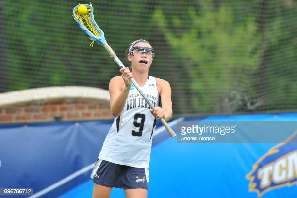 Erin Harvey of the College of New Jersey passes the ball upfield against Gettysburg College during the Division III Women's Lacrosse Championship...
