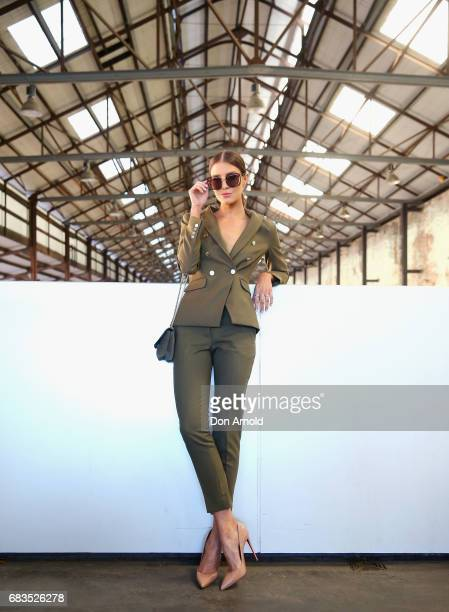 Erin Holland wearing Farage tuxedo Christian Louboutinshoes sungalsses Mimi and Mimco bag during MercedesBenz Fashion Week Resort 18 Collections at...