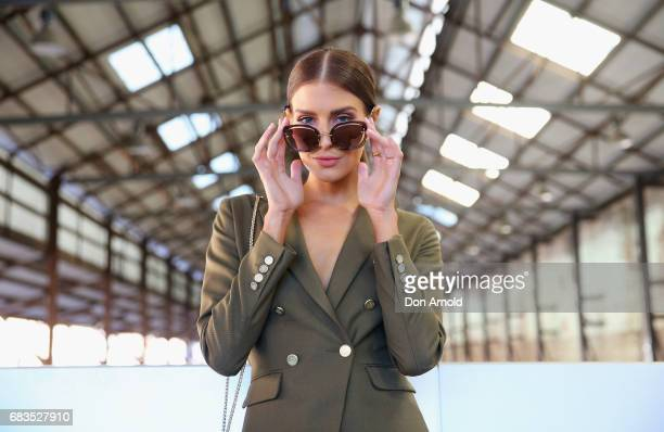 Erin Holland wearing Farage tuxedo, Christian Louboutinshoes, sungalsses Mimi and Mimco bag during Mercedes-Benz Fashion Week Resort 18 Collections...