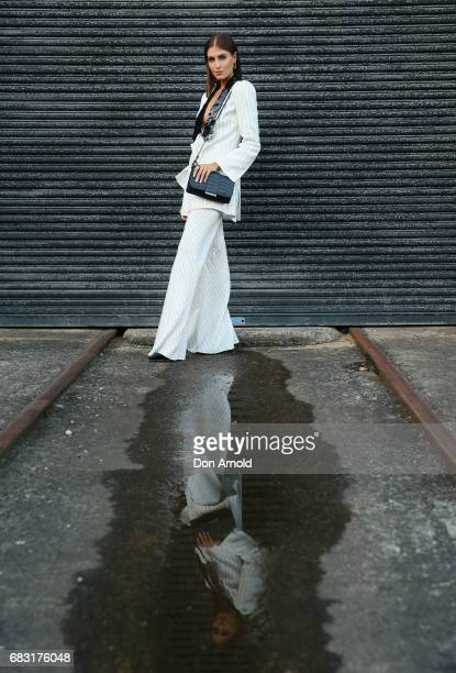 Erin Holland wears Sass and Bide outfit Mimco bag and Swarovski jewellery during MercedesBenz Fashion Week Resort 18 Collections at Carriageworks on...
