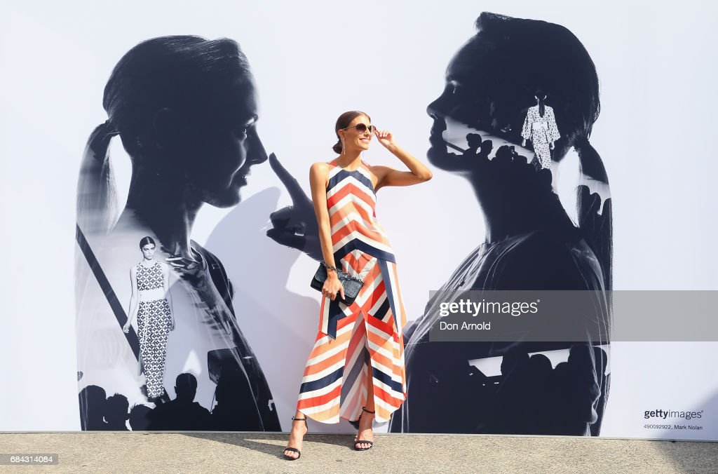 Erin Holland wears Sass and Bide outfit, Prada sunglasses, Siren shoes and Mimco clutch during Mercedes-Benz Fashion Week Resort 18 Collections at Carriageworks on May 18, 2017 in Sydney, Australia.