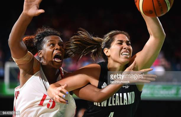 Erin Kalani Purcell of New Zealand contests the ball with Deolinda Gimo of Mozambique during the womens Qualifying Final between Mozambique and New...