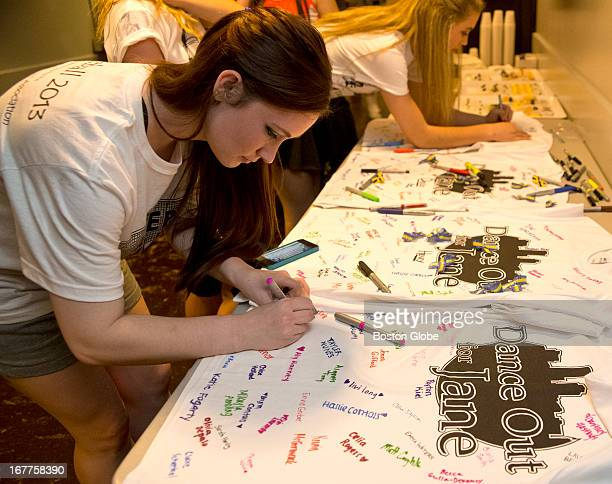 Erin Kiley a step dancer from Fairfield Conn and a dancer with the Lenihan School signs a Tshirt backstage for Jane Richard during a benefit called...