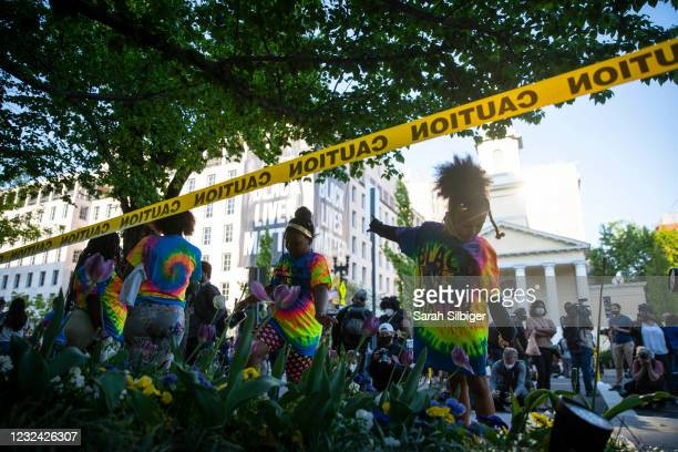 Erin Lee, left and Mahkhyieah Lee, right, dance following the verdict of the Derek Chauvin trial at Black Lives Matter Plaza near the White House on...