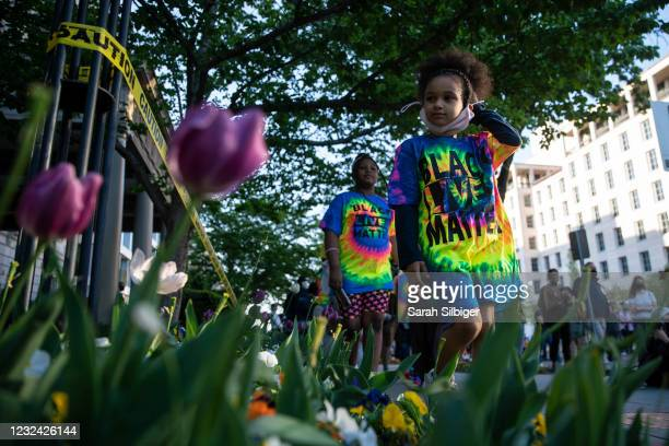 Erin Lee, left and Mahkhyieah Lee, right, visit Black Lives Matter Plaza near the White House following the verdict of the Derek Chauvin trial on...