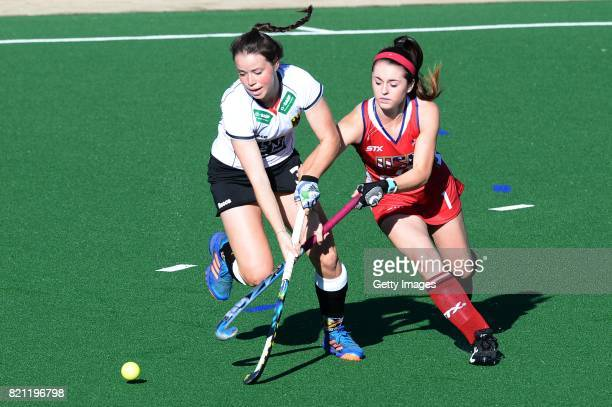 Erin Matson of United States of America tackles Amelie Wortmann of Germany during day 9 of the FIH Hockey World League Women's Semi Finals final...