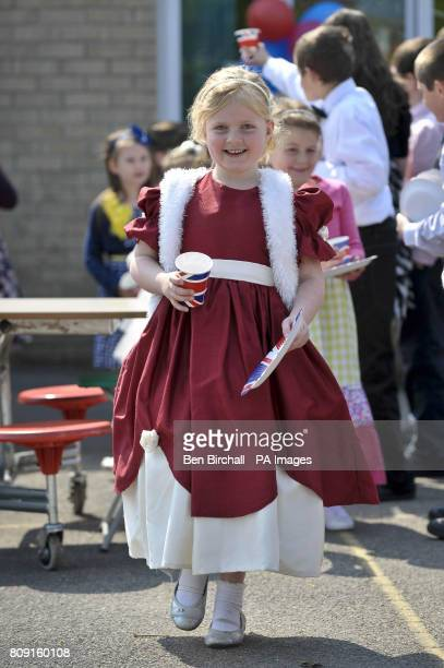 Erin McGowan aged six dressed as a princess gets her Union flag paper cup and plate at the Bucklebury Church of England Primary School Royal wedding...