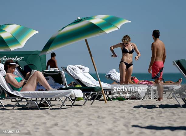 Erin McGrath and Vinnie Miliano prepare for a day at the beach after their return flight to New York was delayed until Thursday when most Northeast...