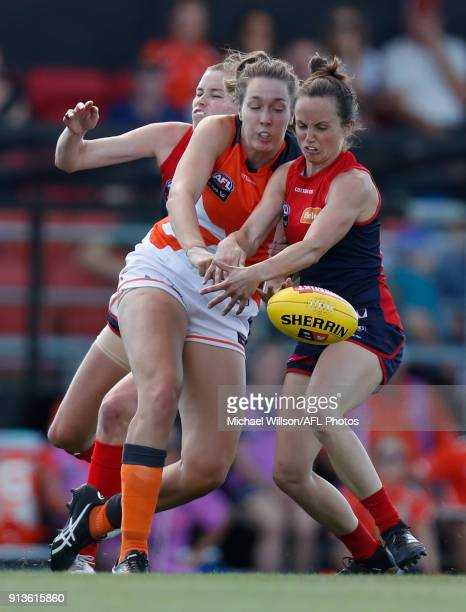 Erin McKinnon of the Giants and Daisy Pearce of the Demons compete for the ball during the 2018 AFLW Round 01 match between the Melbourne Demons and...