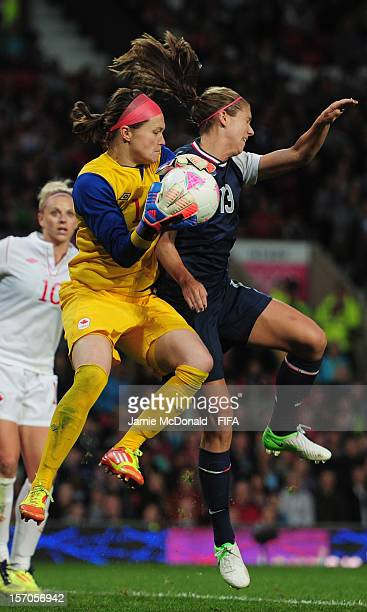 Erin McLeod of Canada battles with Alex Morgan of USA during the Women's Football Semi Final match between Canada and USA on Day 10 of the London...
