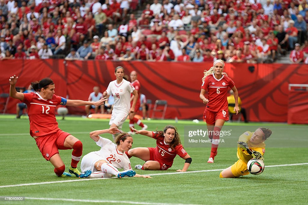 Erin McLeod of Canada makes a brilliant save from Vanessa Bernauer of Switzerland during the FIFA Women's World Cup 2015 Round of 16 match between Canada and Switzerland at BC Place Stadium on June 21, 2015 in Vancouver, Canada.