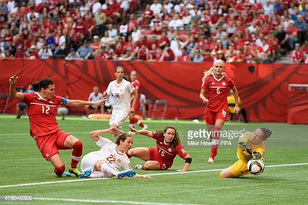 Erin McLeod of Canada makes a brilliant save from Vanessa Bernauer of Switzerland during the FIFA Women's World Cup 2015 Round of 16 match between...