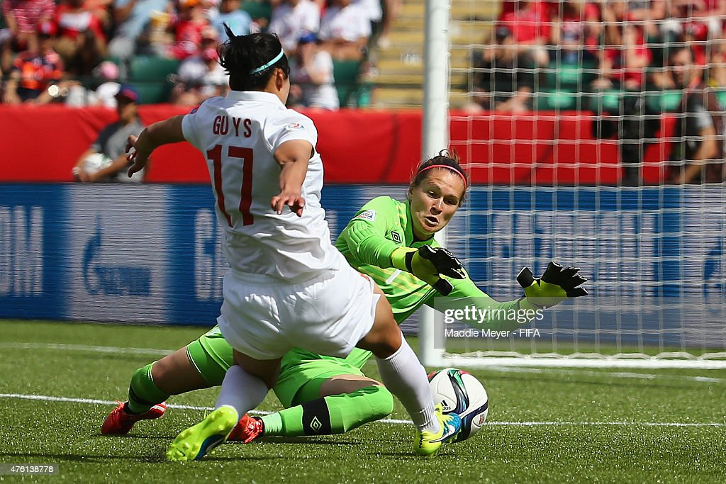Erin McLeod #1 of Canada makes a save against Gu Yasha #17 of China PR during the FIFA Women's World Cup Canada 2015 Group A match between Canada and China PR at Commonwealth Stadium on June 6, 2015 in Edmonton, Alberta, Canada.