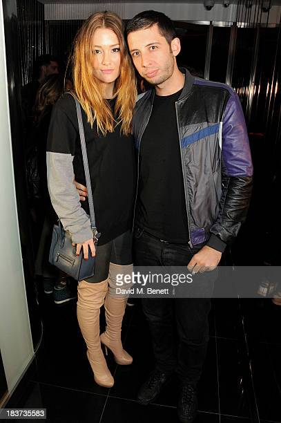 Erin McNaught and Example attend the launch of The Vinyl Collection curated by Annie Mac and the AMP 2013 album at W London Leicester Square on...