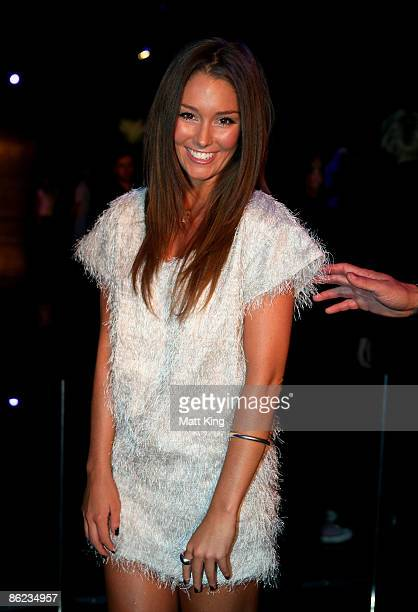 Erin McNaught arrives at the Nicola Finetti catwalk show at the Overseas Passenger Terminal, Circular Quay on day one of Rosemount Australian Fashion...