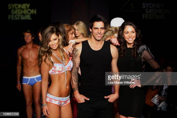 Erin McNaught Mitchell Johnson and Giaan Rooney on the catwalk during the Hot In The City Intimates group show as part of Rosemount Sydney Fashion...