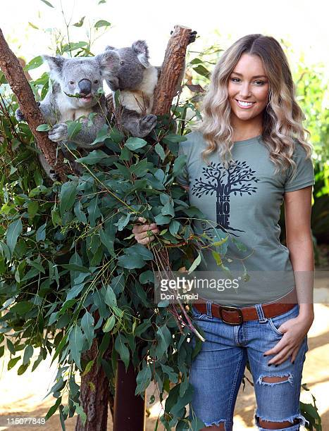 Erin McNaught poses alongside a koalas Jay and Syd after being announced as the Australian Koala Foundation's 'Cuddles for Koalas' ambassador at the...