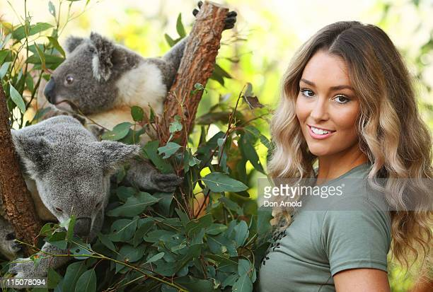 Erin McNaught poses alongside koalas Jay and Syd after being announced as the Australian Koala Foundation's 'Cuddles for Koalas' ambassador at the...