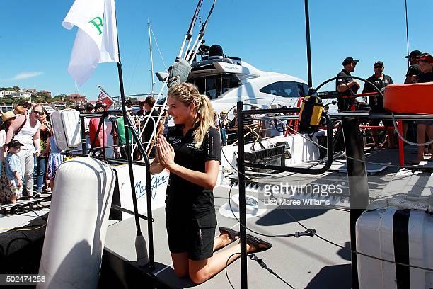Erin Molan pretends to pray during Perpetual LOYAL's Boxing Day Bon Voyage at Rose Bay Marina on December 26 2015 in Sydney Australia