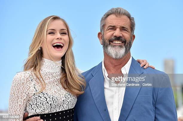 Erin Moriarty and Mel Gibson attend the Blood Father photocall during the 69th annual Cannes Film Festival at Palais des Festivals on May 21 2016 in...