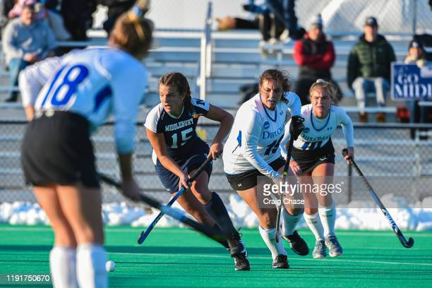 Erin Nicholas of Middlebury dribbles among Franklin Marshall players during the Division III Women's Field Hockey Championship held at Spooky Nook...