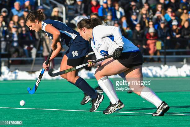 Erin Nicholas of Middlebury dribbles past Colleen Francis of Franklin Marshall during the Division III Women's Field Hockey Championship held at...