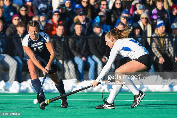 Erin Nicholas of Middlebury dribbles past Melissa Gula of Franklin Marshall during the Division III Women's Field Hockey Championship held at Spooky...