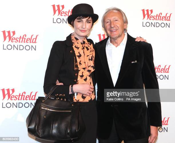 Erin O'Connor and Harold Tillman Chairman of The British Fashion Council arrive at 'The Greatest Fashion Show on Earth' held at Westfield shopping...