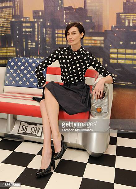 Erin O'Connor attends a photocall to launch the new personal shopper service at Heathrow Airport at Somerset House on October 8 2013 in London England