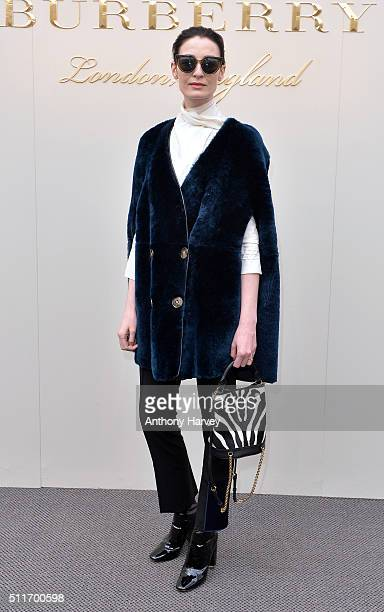 Erin O'Connor attends the Burberry show during London Fashion Week Autumn/Winter 2016/17 at Kensington Gardens on February 22 2016 in London England